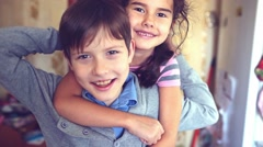 happiness boy girl hugging shout brother and sister - stock footage