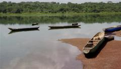 Stock Video Footage of Africa fish boats  big river of Bolola