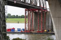 Industrial carrying platform supporting a bridge deconstruction on rhine rive Stock Photos