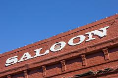 Vintage saloon letters on a red brick building in Nevada City - stock photo