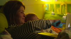 Boy and His Mother Interested with Laptop - stock footage