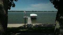Private pier and yacht. Clear Lake, Iowa, USA. Stock Footage