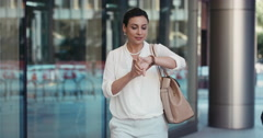 Beautiful Smart Middle Eastern woman walking to work entering glass corporate Stock Footage