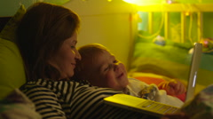 Boy and Mother Watching Bedtime Story in Laptop Stock Footage