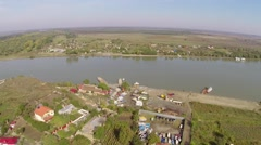 Aerial view of a small village and Danube before flowing into the sea. Stock Footage