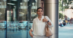 Beautiful Smart Middle Eastern woman walking to work entering glass corporate Arkistovideo