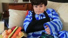 Child  with injured arm and bandage Stock Footage
