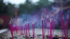 Smoking incense in temple burner Stock Footage