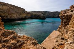 Sea bay in stone desert. Gozo Malta Stock Photos