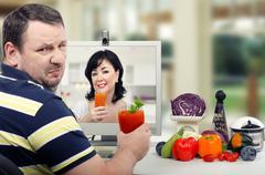 Stock Photo of Man changing his mind to try detox drink