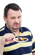 Man has a deep-seated aversion to dried fruits - stock photo