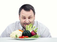 Stock Photo of Bearded man likes vegetables