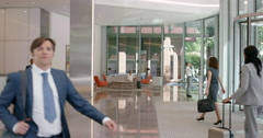 Portrait of Mature Businessman at work in busy office lobby Stock Footage