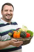 Stock Photo of Retailer with a basket of fresh vegetables