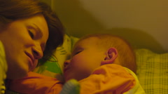 Mother and Son Nestling in Bed before Sleep Stock Footage