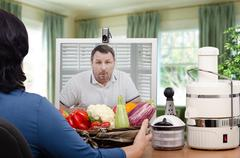 Stock Photo of Amazed man looking at vegetables