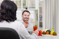 Stock Photo of Woman made delicious flat belly smoothie