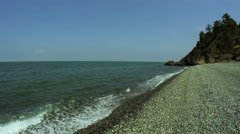 Stones on beach wild stony shore of Black sea Stock Footage
