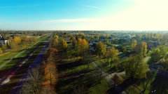 Low altitude flight in green autumn park. Aerial footage. Stock Footage