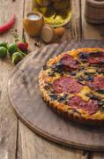 Delicious quiche with chorizo, nuts and sharp cheese - stock photo