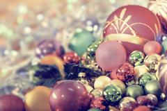 Christmas background with baubles and Christmas lights, shallow DOF, focus on - stock photo