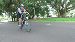 Bicyclists on street - stock footage