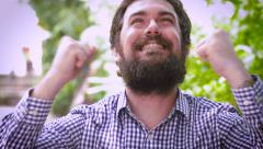 Portrait of a bearded man celebrating and being extremely happy Stock Footage