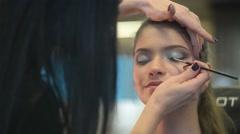 Make Up Artist And Beautiful Model Brunette On Set Stock Footage