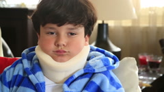 Sick child with neck brace 14 Arkistovideo