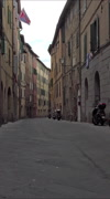 Siena Italy Corteo winding narrow alley road vertical HD 005 Stock Footage