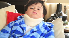 Sick child with neck brace Stock Footage