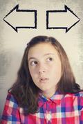Portrait of beautiful teenage girl in dilemma Stock Photos