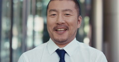Portrait of Japanese Businessman outside corporate office building Stock Footage