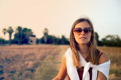 Beautiful girl in countryside  warm filter applied Stock Photos