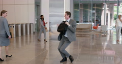 Crazy happy businessman dancing in corporate lobby Arkistovideo