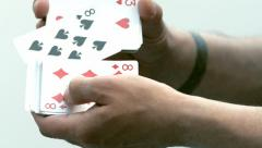 Person Shuffling a Pack of Playing Cards Stock Footage