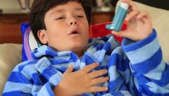 Child using asthma inhaler 2 - stock footage