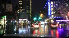 Car moving through rainy city, night, Vancouver Stock Footage