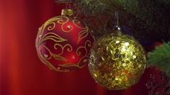 Christmas balls over bright red background - stock footage