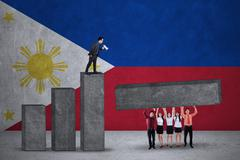 Entrepreneurs make graph with flag of Philippines - stock photo