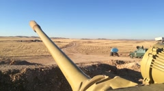 POV of Tank Canon In Foreground of Barren Iraq Background Stock Footage