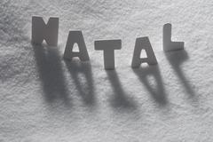 Stock Photo of White Word Natal Mean Christmas On Snow