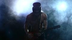 brutal rock strip man playing bass guitar, smoke, slow motion - stock footage