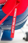 remove before flight on the aircraft fuselage - stock photo