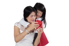 Happy mother and child open a gift - stock photo