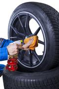 Mechanic wash the rim of tire Stock Photos