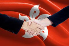 People shaking hands with flag of Hong Kong Stock Photos