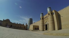 Panorama of the Kuhna Ark citadel walls and Kalta Minor Minaret in Khiva Stock Footage