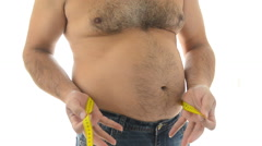 Fat mature man measuring his belly with measurement tape Stock Footage