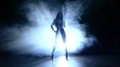 silhouette of pretty stripper. Slow motion. smoke - stock footage